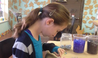 girl making mosaics at breakables